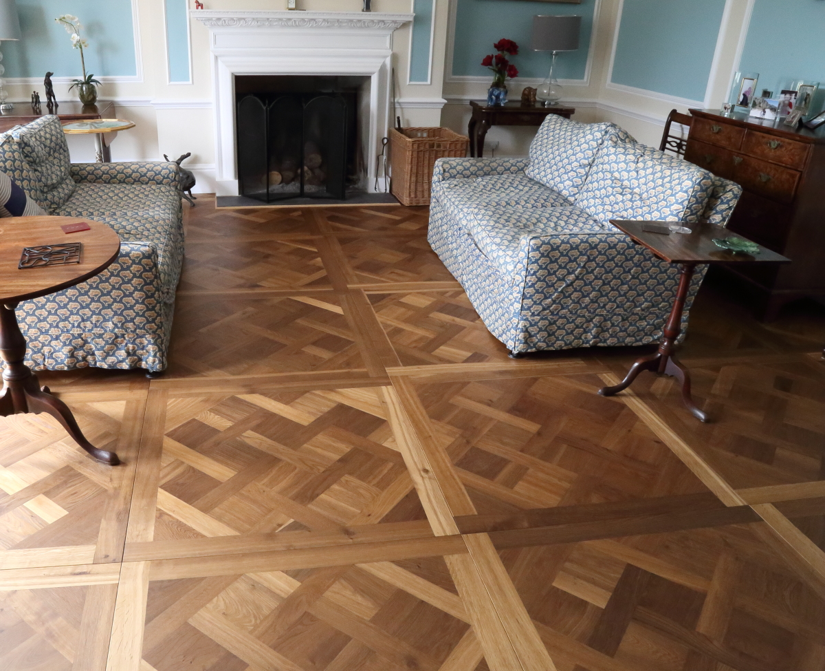 Versailles Oak Panel - a beautiful parquet panel floor. Fumed Oak Versailles Panels available with a border from Hicraft Flooring Product Code HC7603