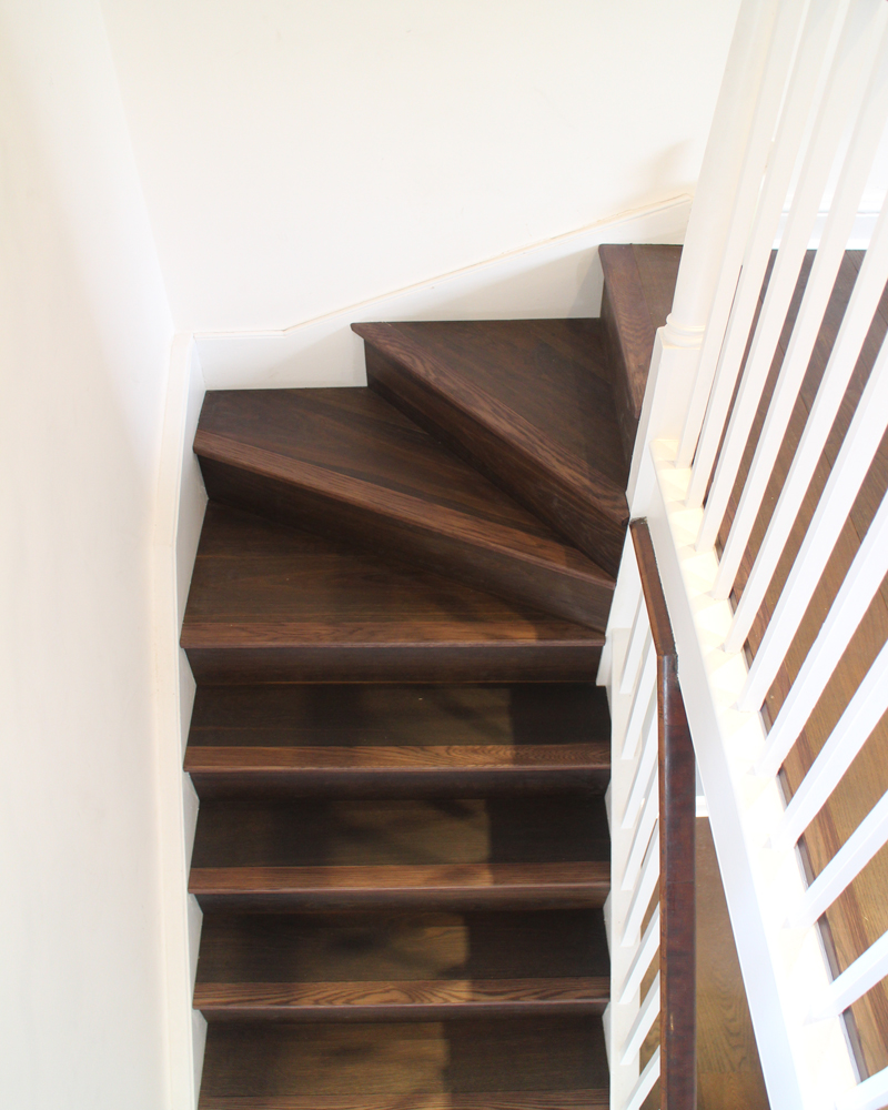 Wooden Flooring for Staircases - Richly fumed oak cladding for a staircase to match the flooring fitted throughout this property