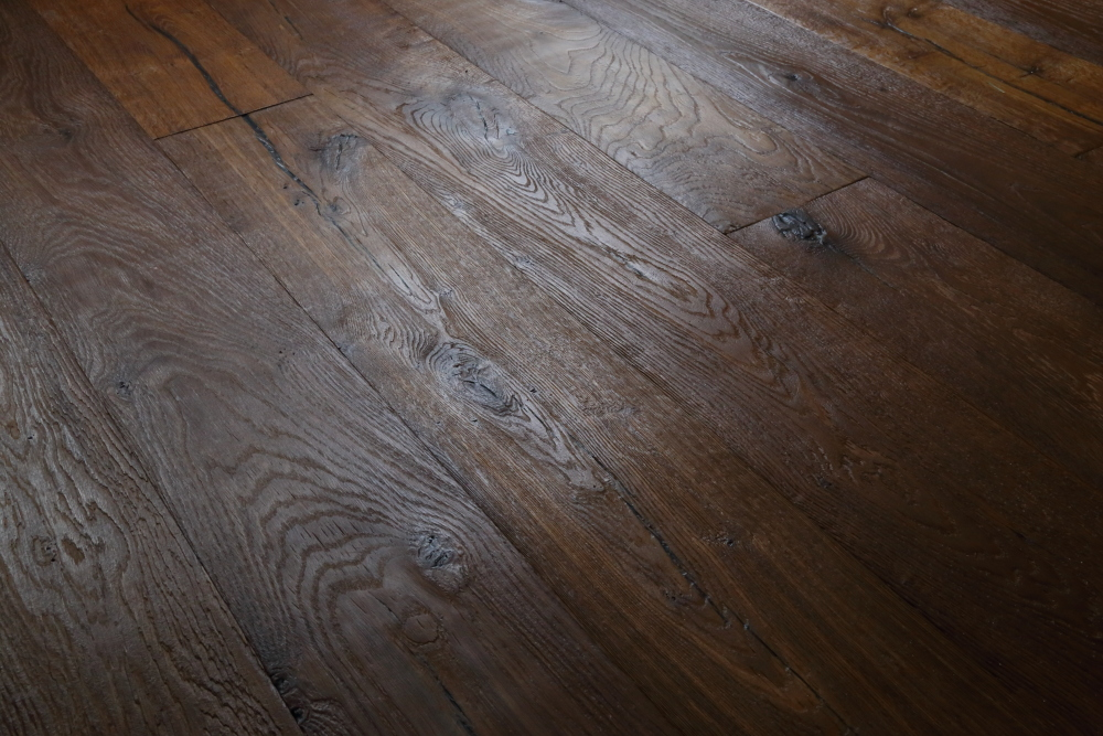 European Oak - Distressed engineered oak, hand finished in Italy. Product code HC7350. Contact Hicraft Flooring for more details.