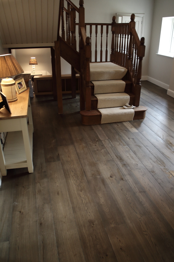 Charcoal Grey Wooden Flooring - Grey Ok Flooring in warm tones. Oak flooring available in several widths up to 240mm.