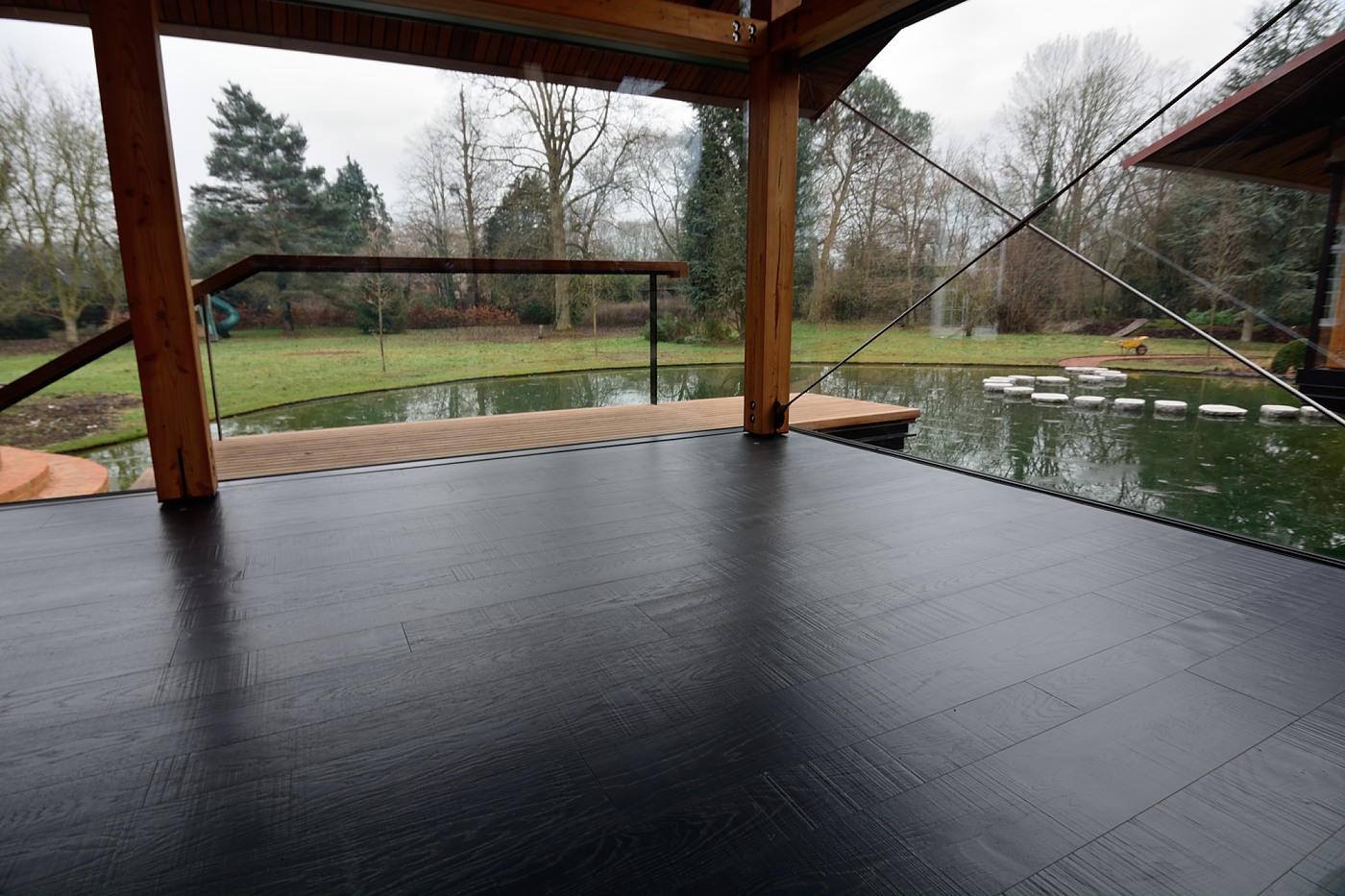 Extra wide flooring available from Hicraft Flooring. Extra wide floorboards really give a space the wow factor as seen here in a mixed width black, distressed wooden floor.