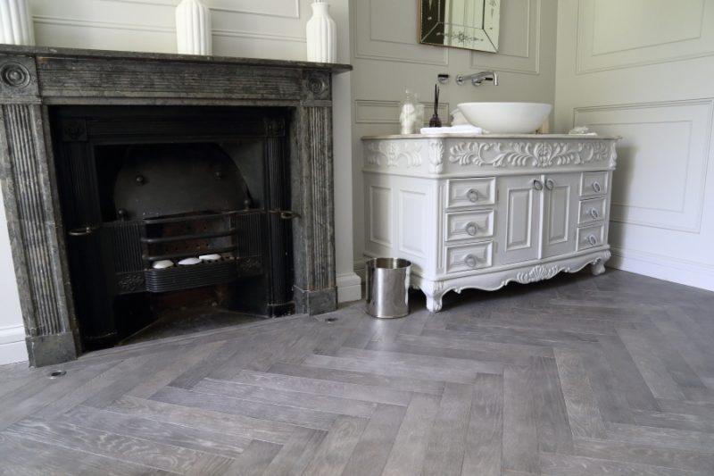 Rich Grey Oak Herringbone oak wooden flooring laid in a bathroom