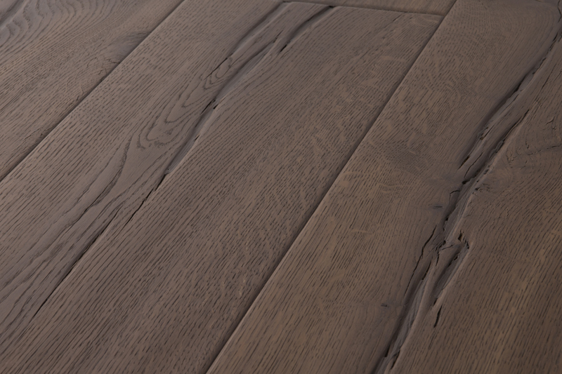 Rich Chocolate Oak Flooring sample board - Rustic grade flooring with natural splits and knots, distressed and smoothly contoured around the natural grains. Double smoked oak flooring, richly coloured and chocolatey.