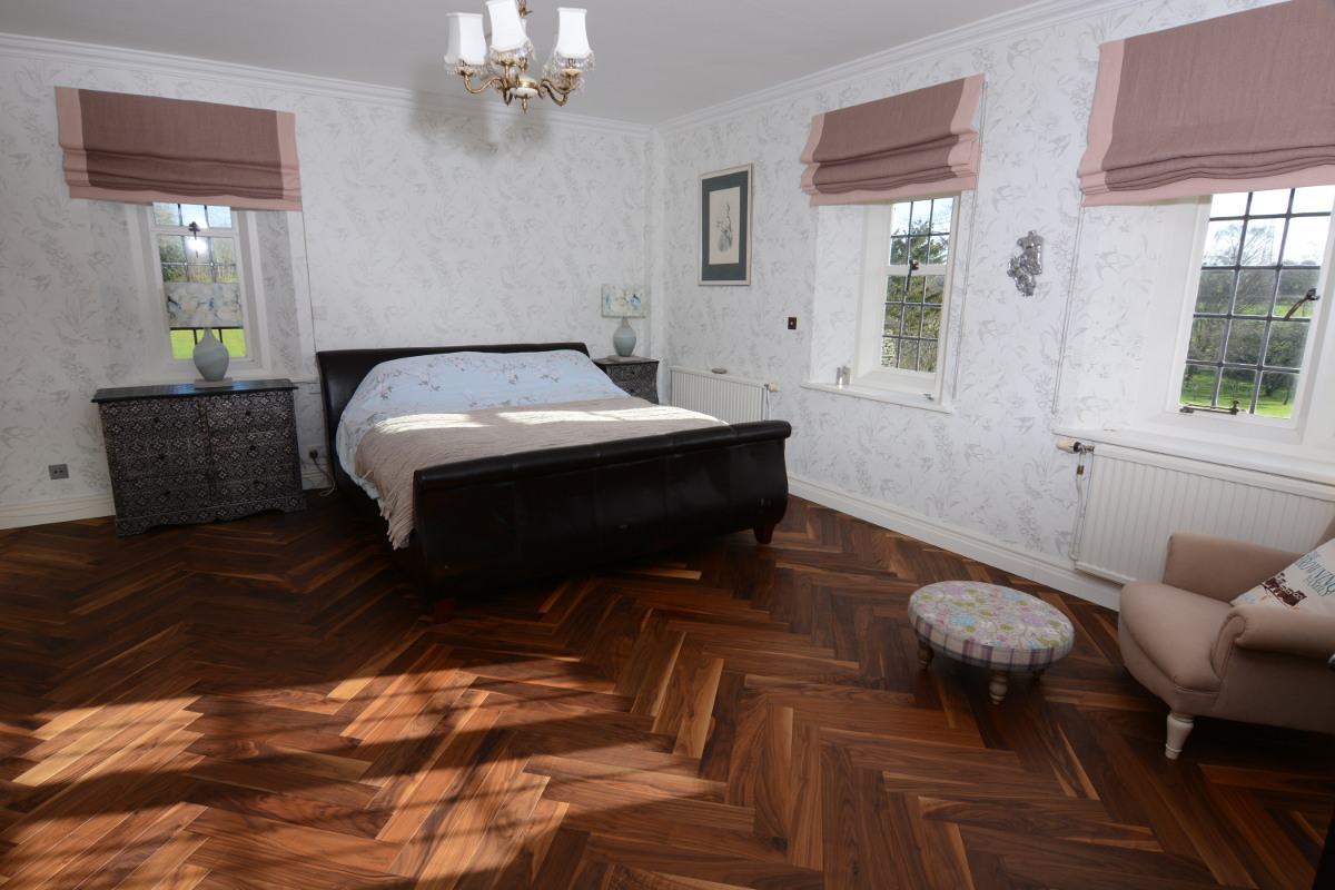 Showing Engineered American Black Walnut Parquet Flooring fitted in a bedroom.
