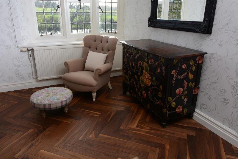 American Balck Walnut Flooring - shown here as a herringbone floor for a bedroom
