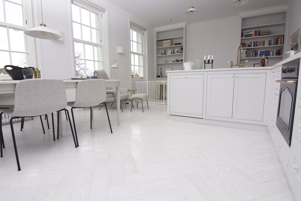 A beautiful white herringbone parquet, lightly brushed to reveal texture and grain