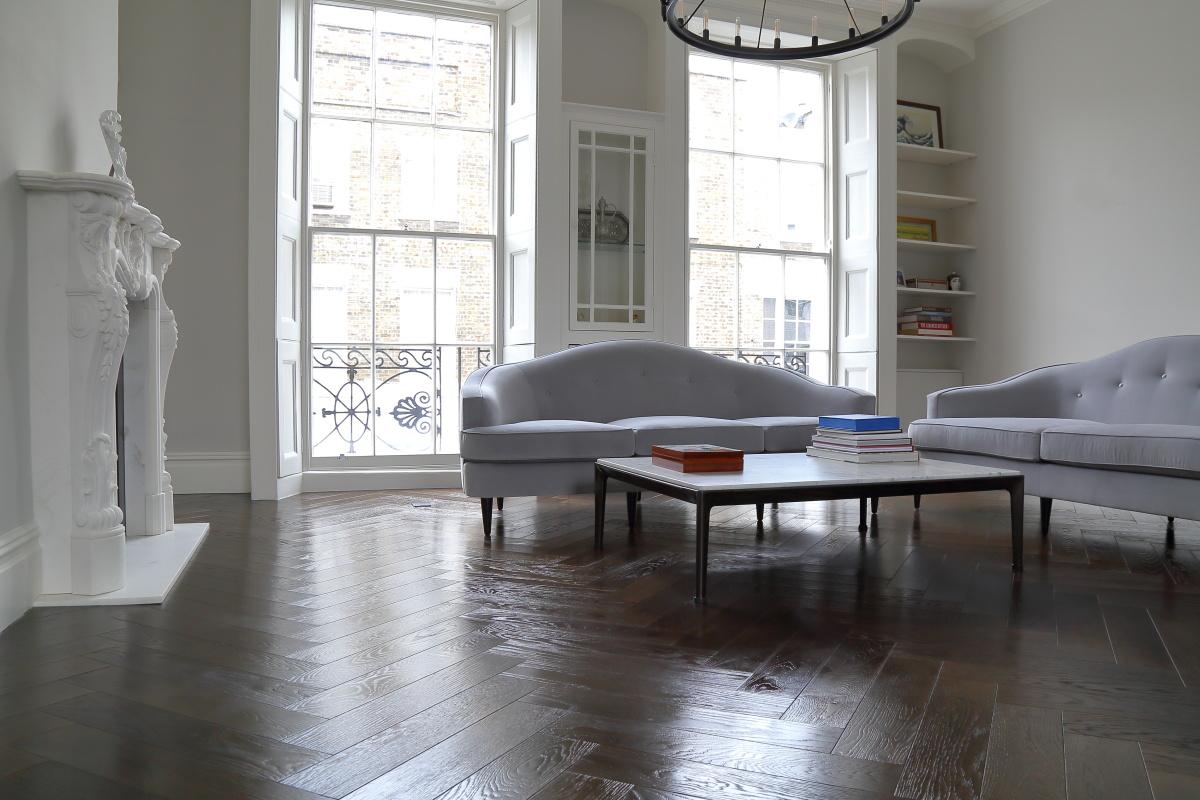 Glossy dark brown herringbone wood flooring